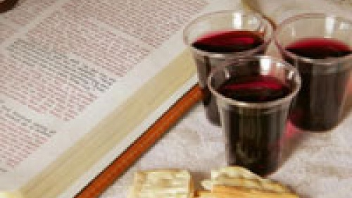 Bread and wine beside bible